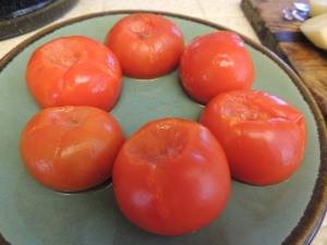 "Thaw six frozen whole tomatoes on the ""defrost fish"" setting of the microwave. Cut in half and discard tough skins."