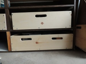 The box drawers have cut out handles in front and back so i can pull a given box out to get to what is stored inside.