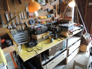 Our garage work area with three new Lou-made drawers in the workbench shelves.