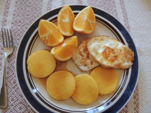 Or, how about fried cornmeal mush with maple syrup, fried eggs, and oranges right off our tree?