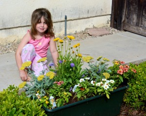 Our granddaughter Megan with her butterfly garden.