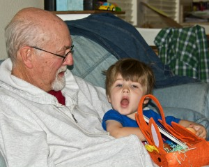 Then Mike settled down in Papa's lap to show him all the goodies in his Easter basket.